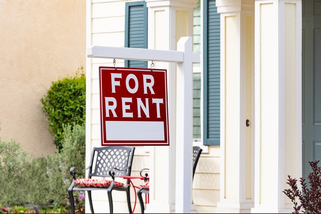 A for rent sign outside of a home that is part of the cost of property management.